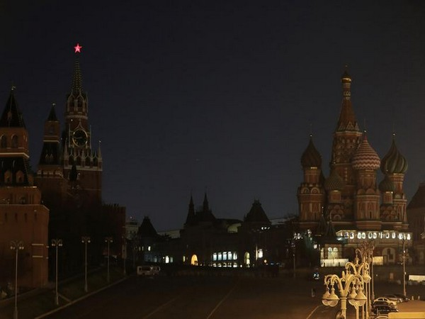 The Kremlin towers, the GUM department store and the St. Basil's Cathedral after the lights are switched off for Earth Hour in Moscow