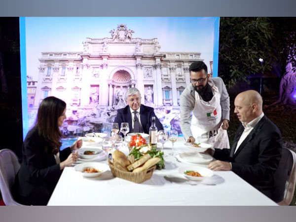 The winner of World Week of Italian Cuisine 2020, Karan Tripathi serves his winning dish to the Ambassador of Italy to India Vincenzo de Luca and his team