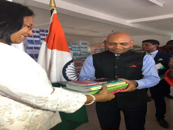 Indian ambassador Abhay Kumar hands over academic text books to Madagascar Minister Blanche Nirina Richard in Antananarivo on Tuesday