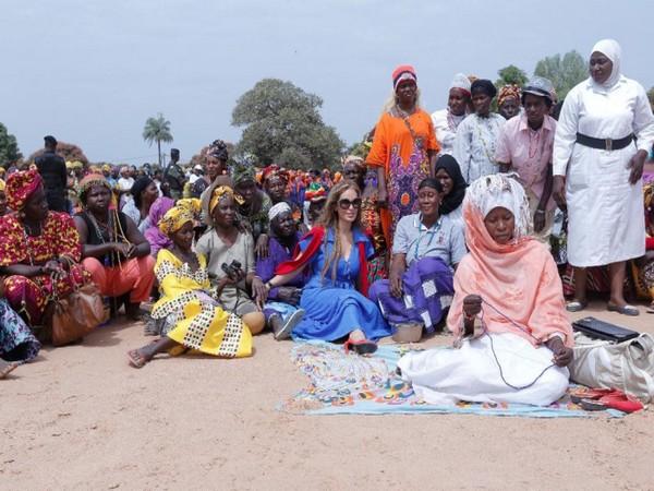 Senator, Dr Rasha Kelej with infertile women during her visit to The Gambia