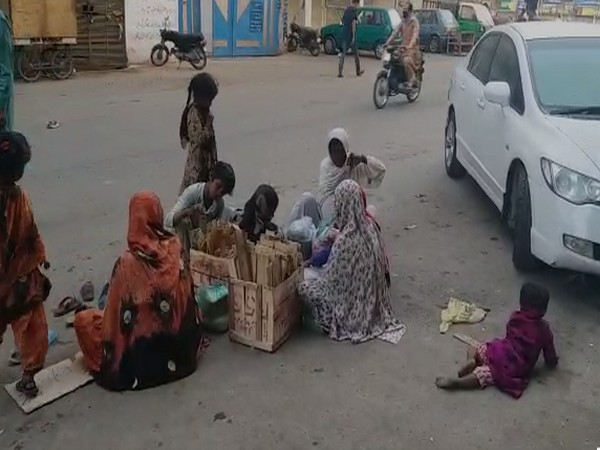 Members of Hindu community in Sindh waiting for supplies of essential goods on streets in Karachi
