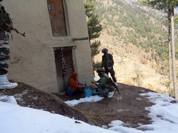 Indian Army Jawans distributing medical kits and rations in a village of J-K's Ramban district.