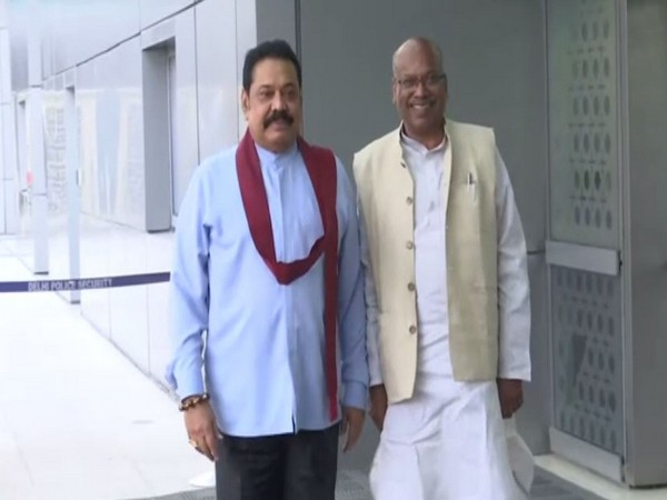 Sri Lankan Prime Minister Mahinda Rajapaksa (L) at the Delhi Airport on Friday. (Photo/ANI)