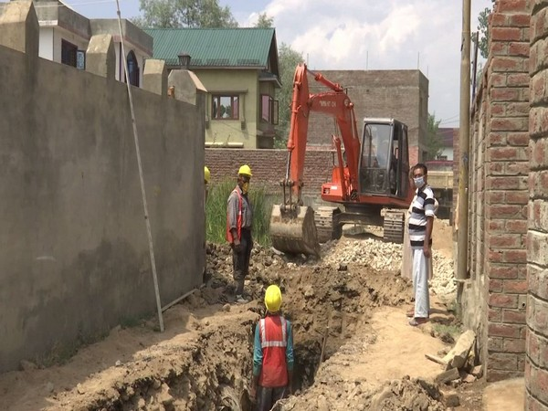Construction of a new drainage system underway in Srinagar. (Photo/ANI)