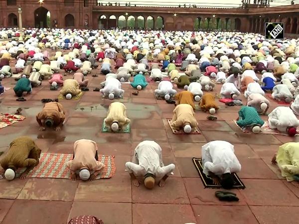 Devotees offer namaz on Eid al-Adha at Jama Masjid