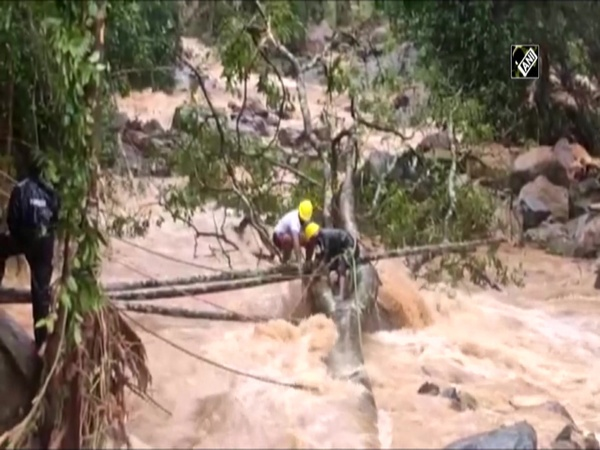 Watch: NDRF makes temporary bridge to rescue stranded in Kerala
