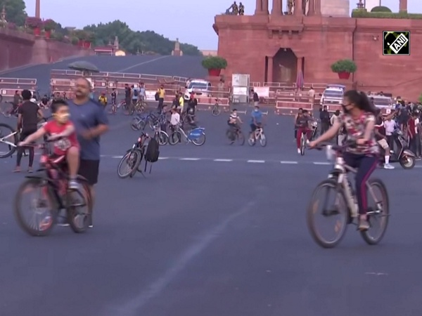 Cyclists enjoy Sunday morning at Delhi's Rajpath