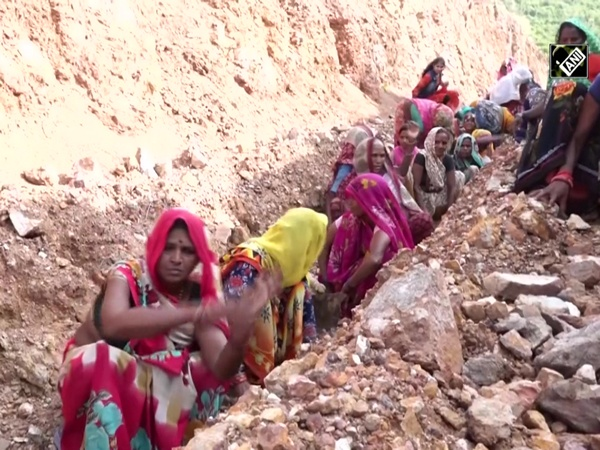 Women carve hill to pave way for water into pond in MP