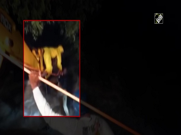 Watch: Locals save man with help of JCB machine from in overflowing stream in Pune