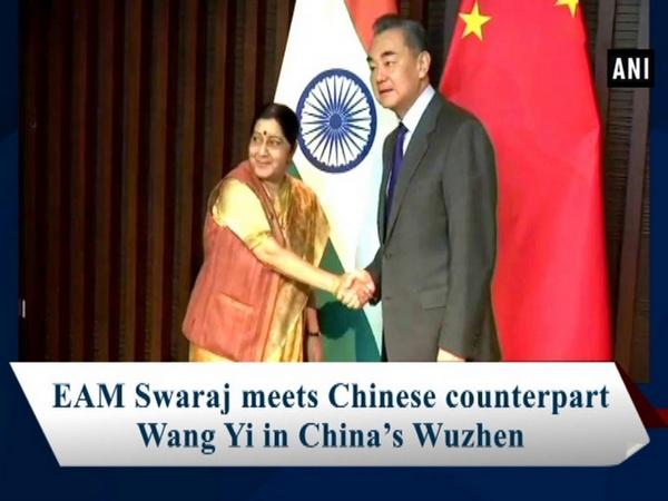 EAM Swaraj meets Chinese counterpart Wang Yi in China's Wuzhen