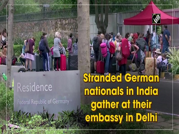 Stranded German nationals in India gather at their embassy in Delhi