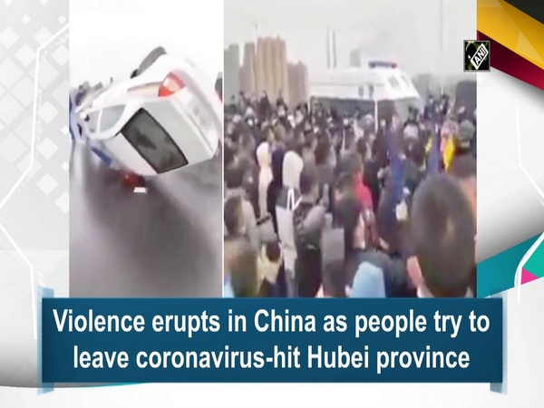 Violence erupts in China as people try to leave coronavirus-hit Hubei province