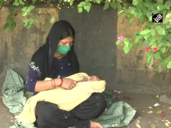 'No money to buy food': Mother of one-month-old waits for train under scorching heat
